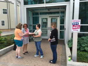 NLPL workers distributing buttons & pamphlets in Corner Brook